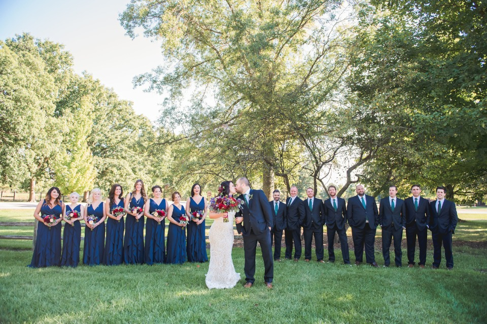 Large bridal party in navy and blue