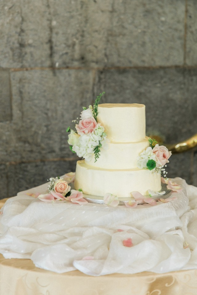 Simple white wedding cake with florals