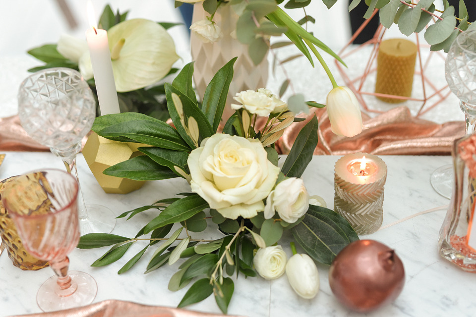 white and copper reception decor