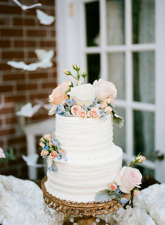 Pretty pastel flowers on antique gold chandelier cake stand