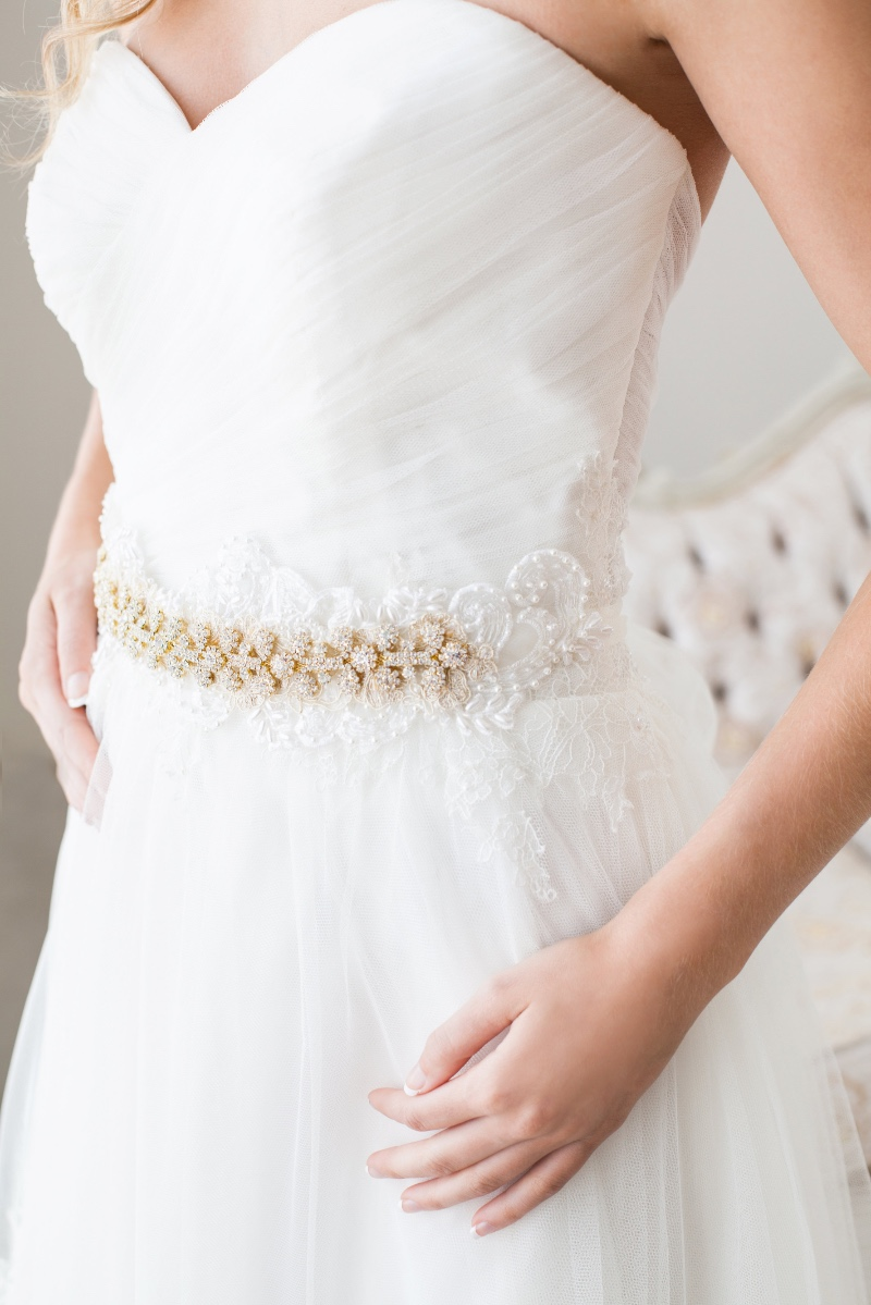 The perfect touch of gold accents in this beautiful rhinestone bridal sash.