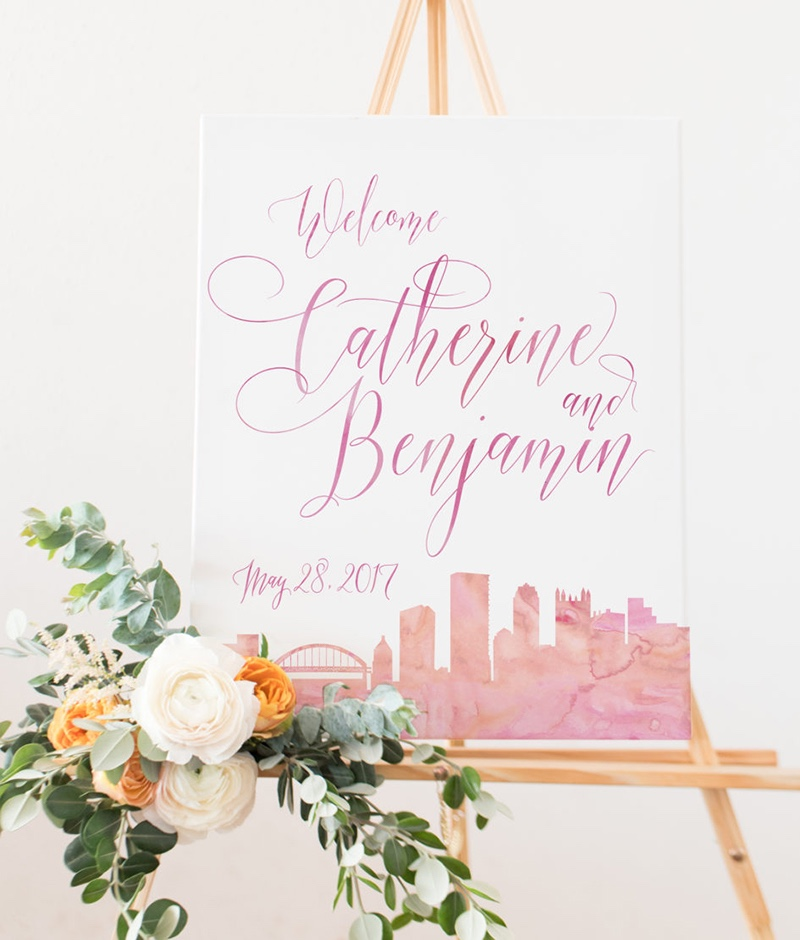 Miss Design Berry's Watercolor Skyline Sign welcomes guests to your event and features a beautiful skyline of your choice – you can