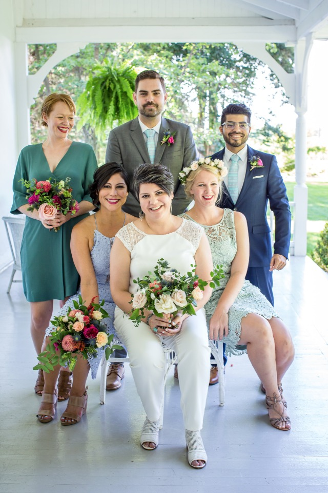 bridal party in blues and greens