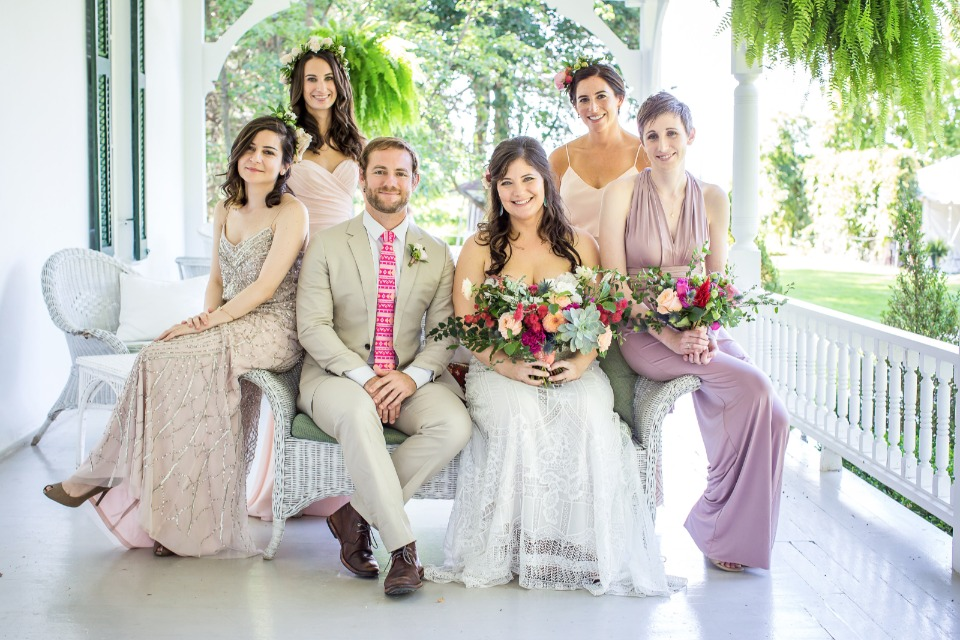 bridal party in pinks and champagne