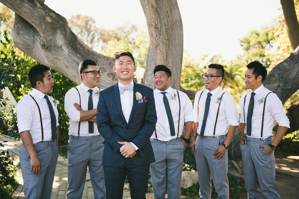 blue and white groomsmen with suspenders