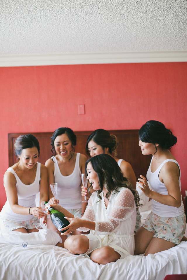 getting ready with bridesmaids and champagne