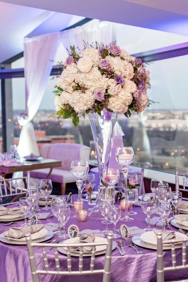 Purple white and silver table decor