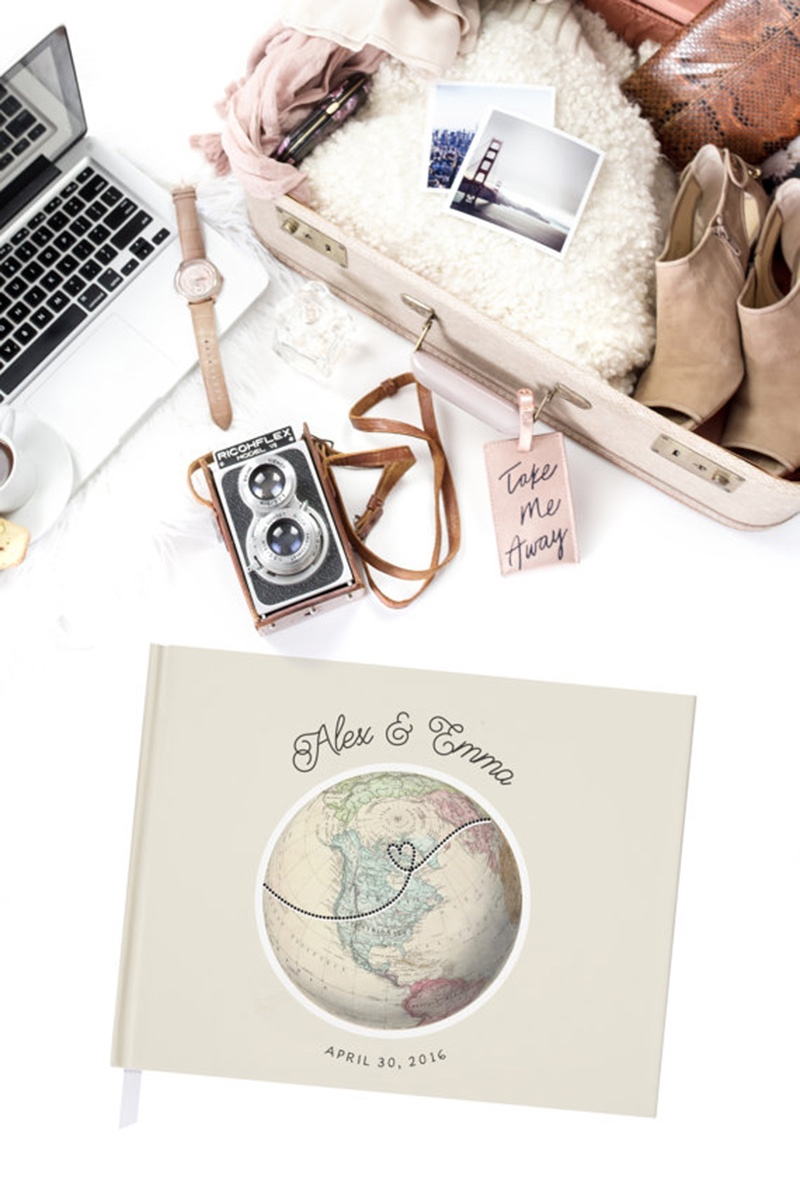 Miss Design Berry's travel themed wedding guest book is customized with a vintage globe featuring the continent of your choice on the