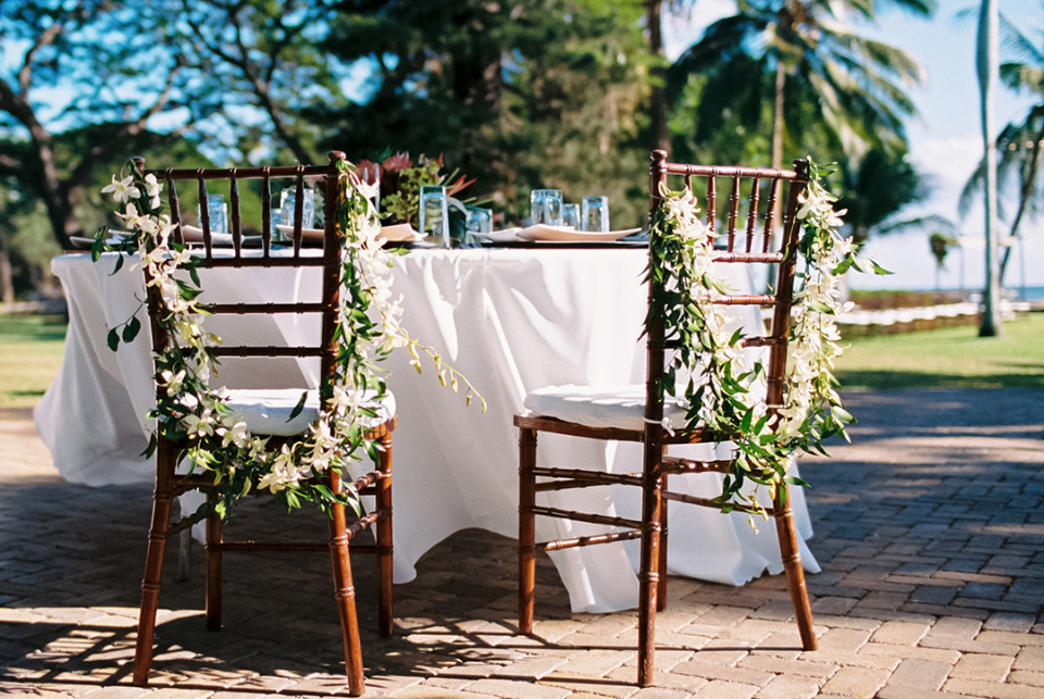 floral garlands for wedding chairs