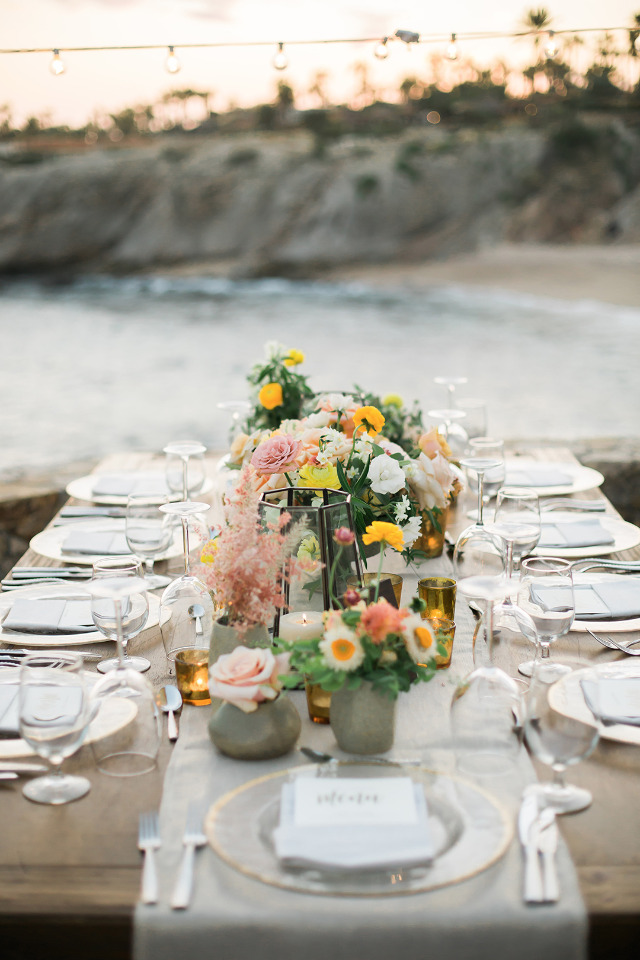 pink yellow and orange wedding reception in Cabo