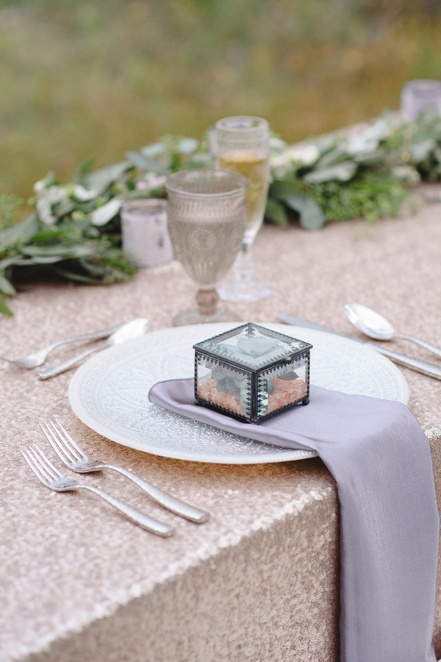champagne and silver table setting