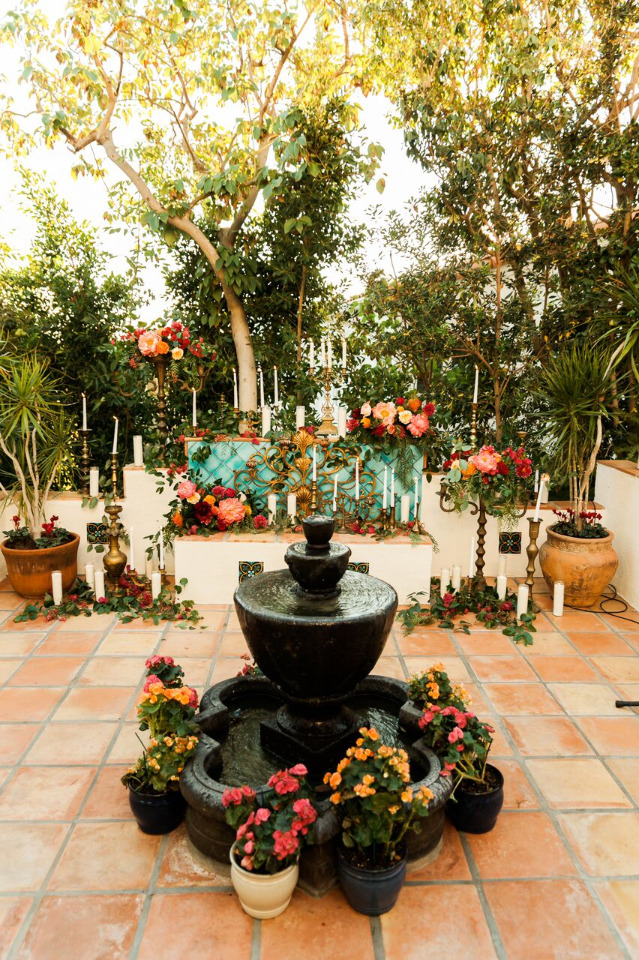 beautiful outdoor wedding ceremony with fountain