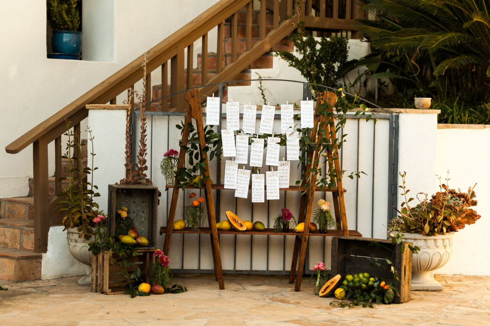hanging wedding seating chart with fruit decor