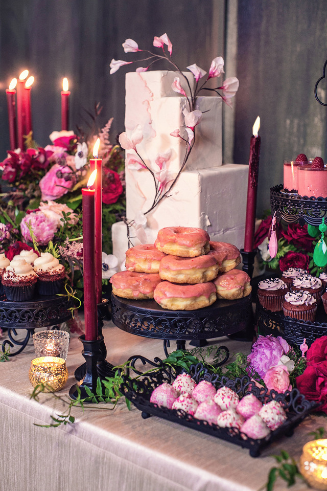 bright pink wedding desserts with red candles