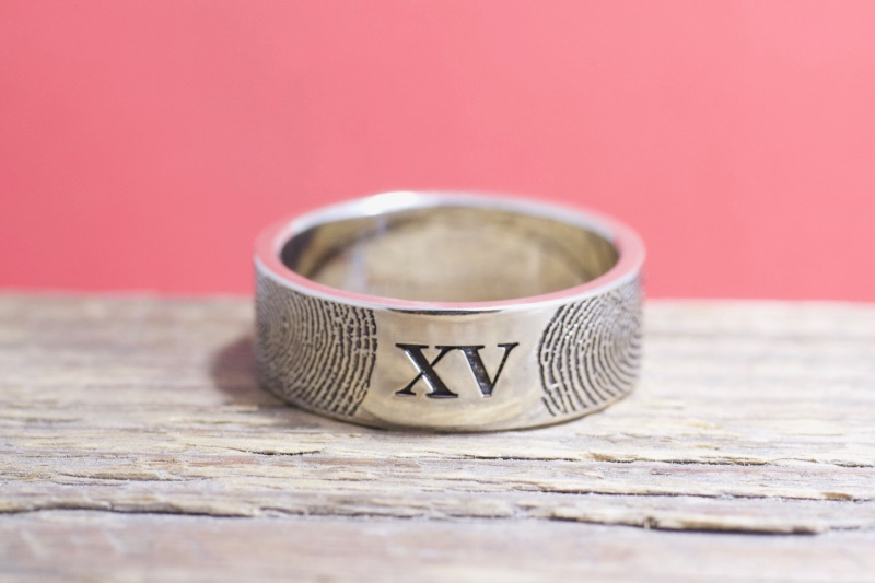 Yes! We can customize our unique rings! This one is made with Roman Numerals! Artisan handcrafted by Brent&Jess in Maine.