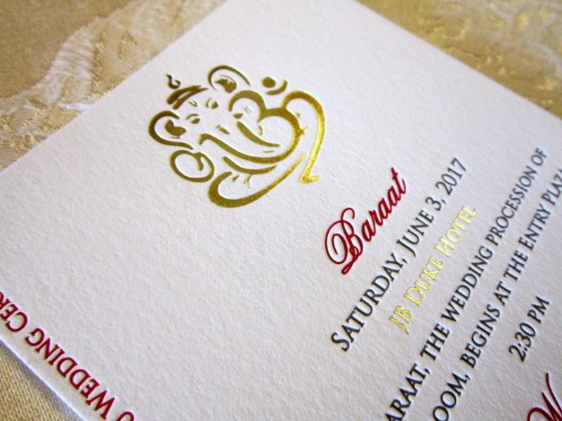 A gorgeous gold foil and letterpressed Ganesh for a Catholic and Hindu ceremony. Designed exclusively by Persnickety Invitation Studio