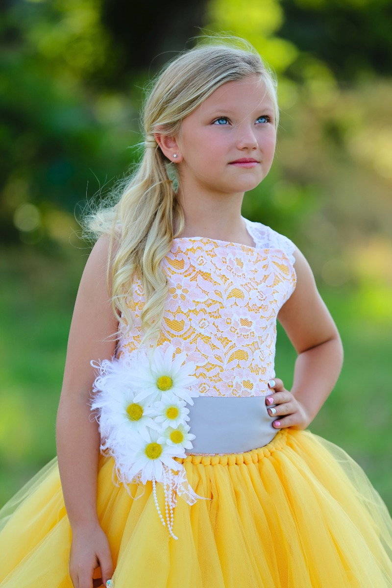 Your flower girl will look like a ray of sunshine in this gorgeous daisy dress custom made from Baby 2B Nashville. Have one custom