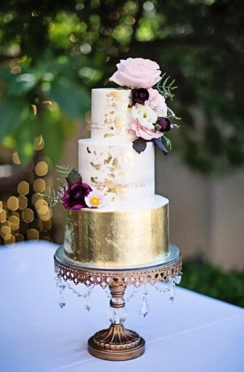 Gold Foil Accented Wedding Cake on Gold Chandelier Cake Stand by Opulent Treasures