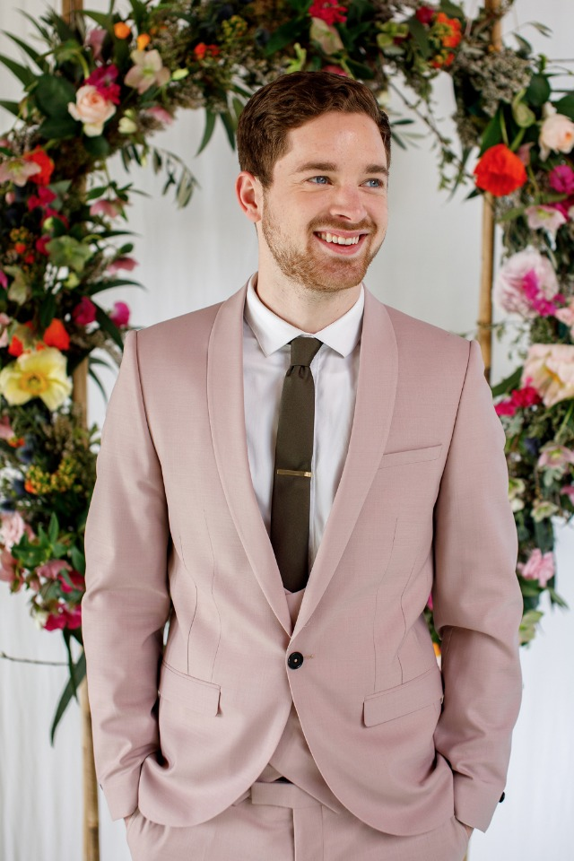 groom in pink suit