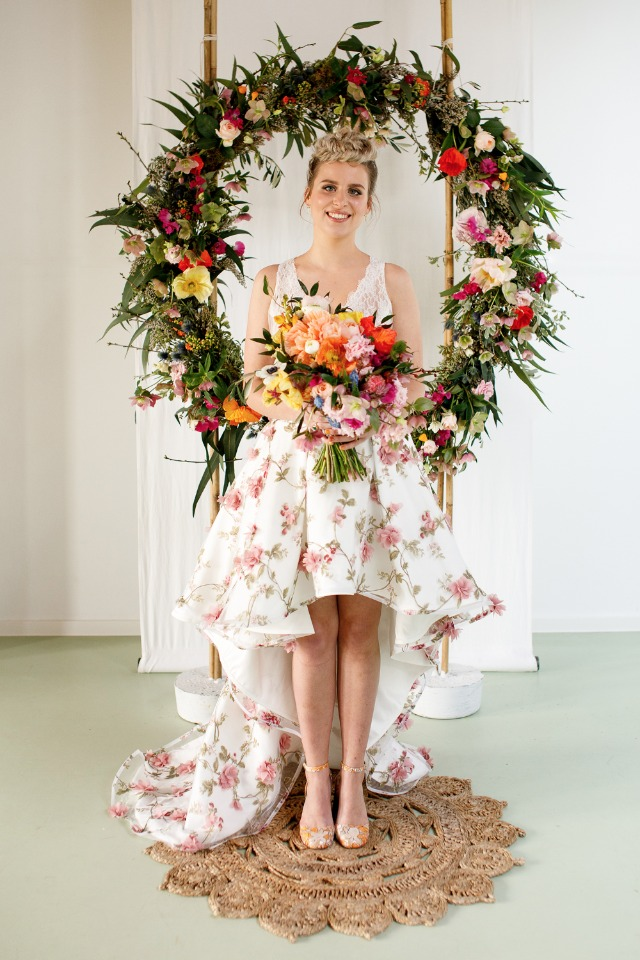 high low skirt and floral wedding wreath backdrop