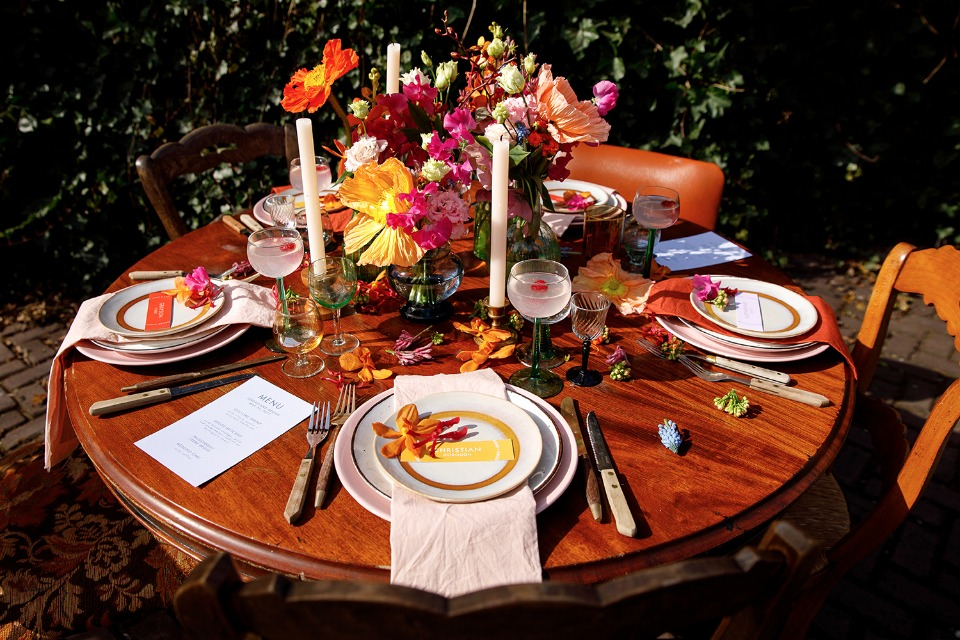 outdoor wedding table with bright centerpiece