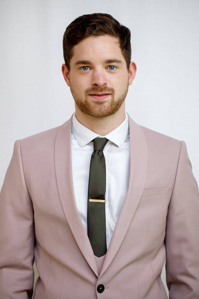 groom in dusty pink suit