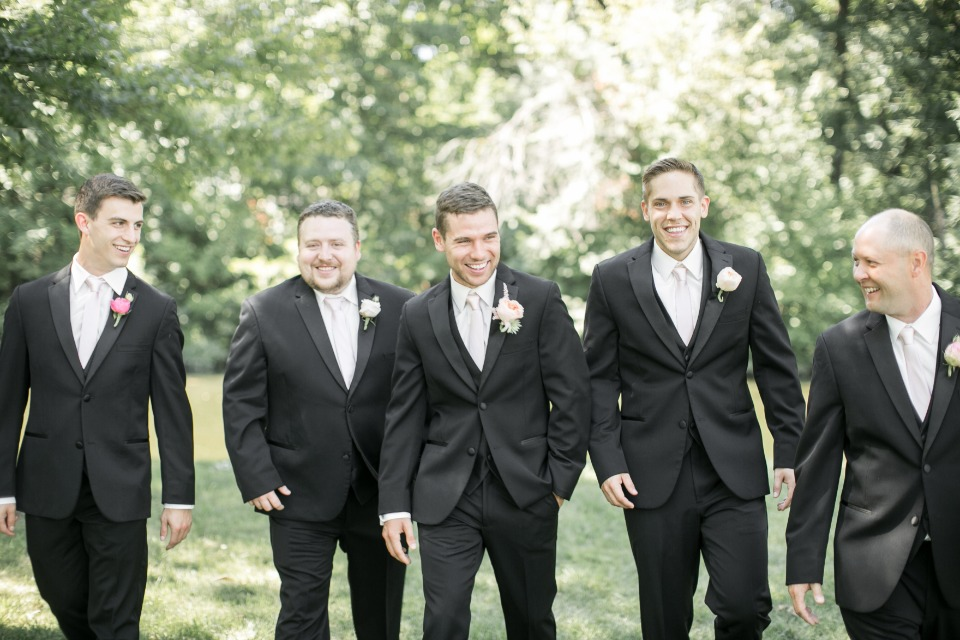groom and his men in black and ivory