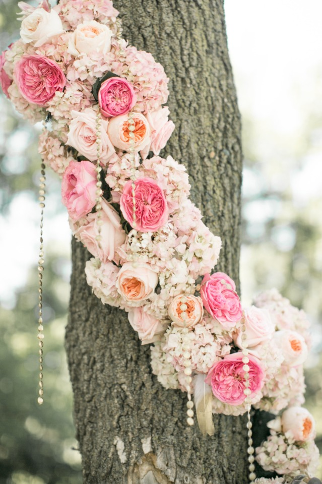 flower garland wrapped trees