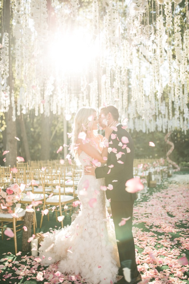 Sunset and petal toss wedding photo idea