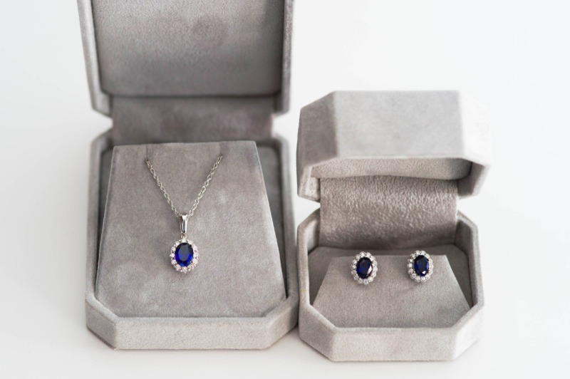 If nothing in the store feels like you, custom jewelry is the way to go! This something blue sapphire halo set was made by J'Adorn