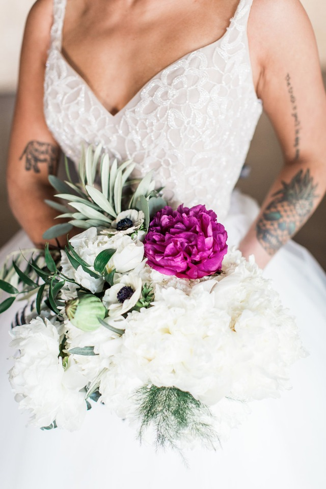 White bouquet with a giant pink peony
