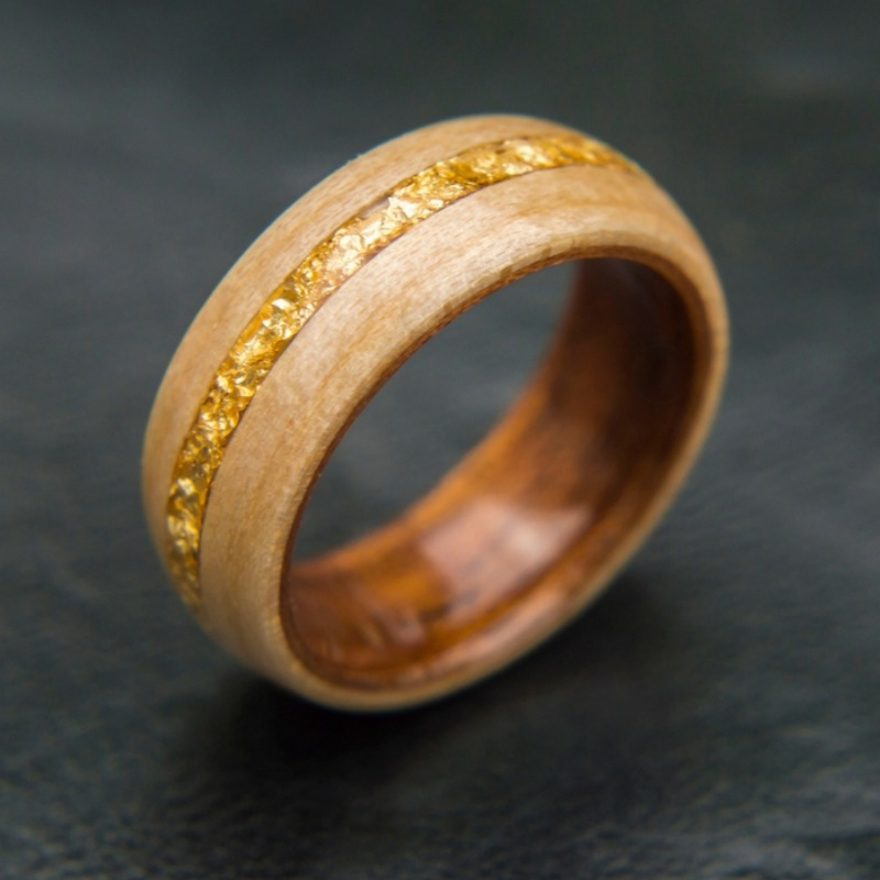 Men's bentwood wedding ring. Handcrafted out of koa wood and maple wood. The center of the ring is inlaid with 18K gold flakes.