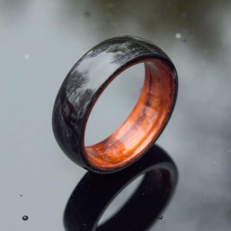 Handmade bentwood wedding ring. The top of the ring is made with a darker koa wood. The interior of the ring is made with a lighter
