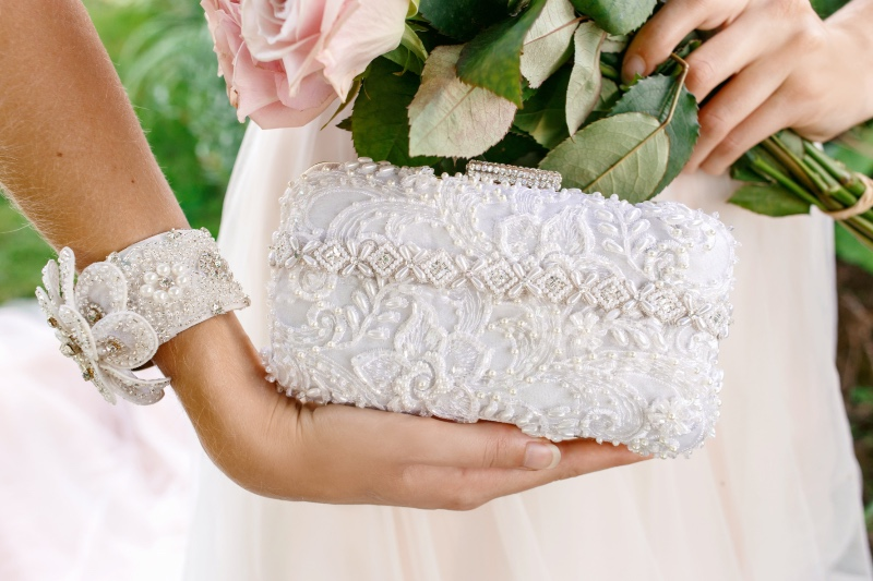 Carry all your small wedding day essentials in a gorgeous beaded bridal clutch.