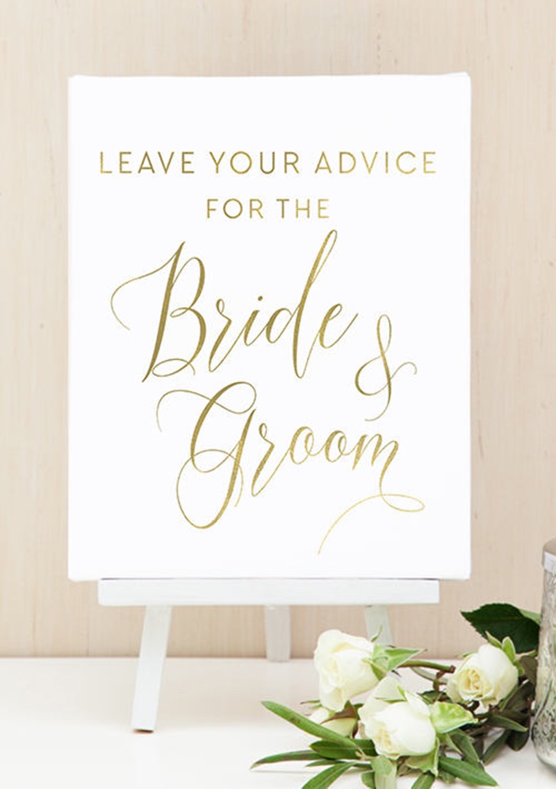 Miss Design Berry's Gold and White Leave Your Advice For the Bride and Groom Sign sign features dynamic type for an elegant yet modern
