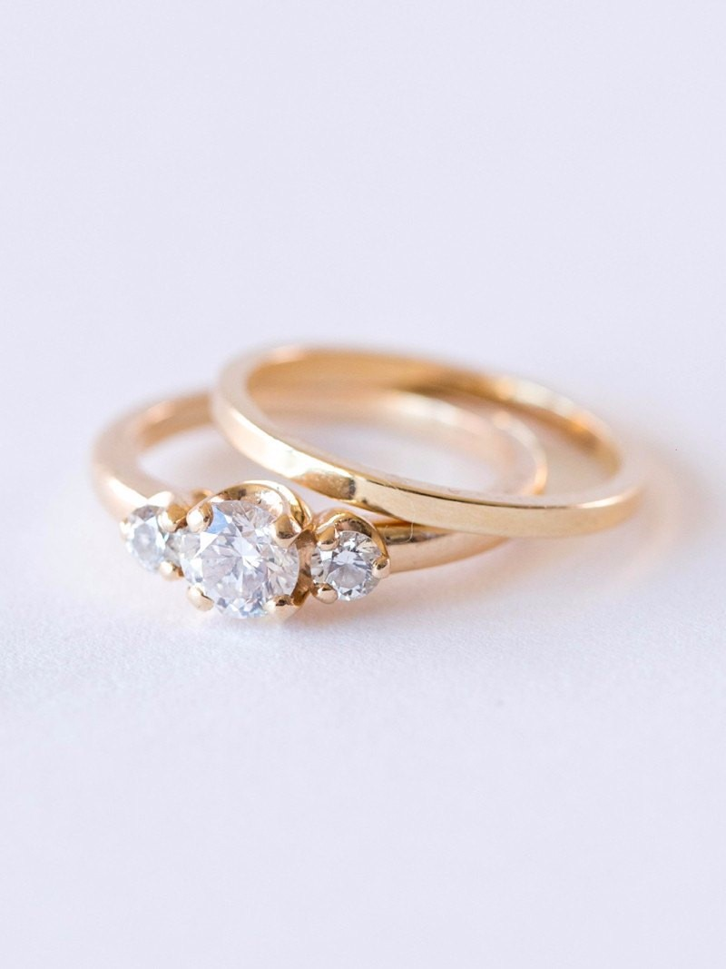 Three gorgeous stones nestled in immaculate yellow gold. Classic, sophisticated, Chloe.