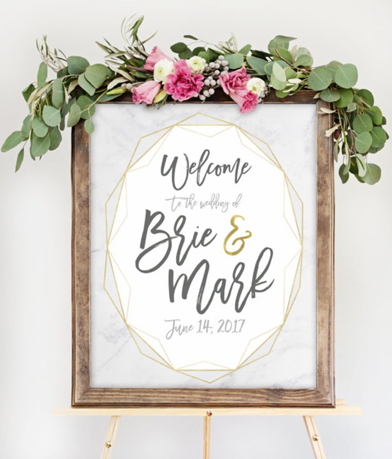 Miss Design Berry's geometric wedding welcome sign features marble and gold for a modern, chic look. You get to customize this sign