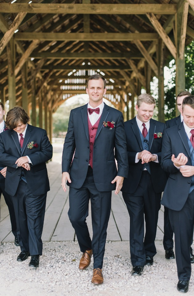 groom and his men in charcoal and burgundy suit