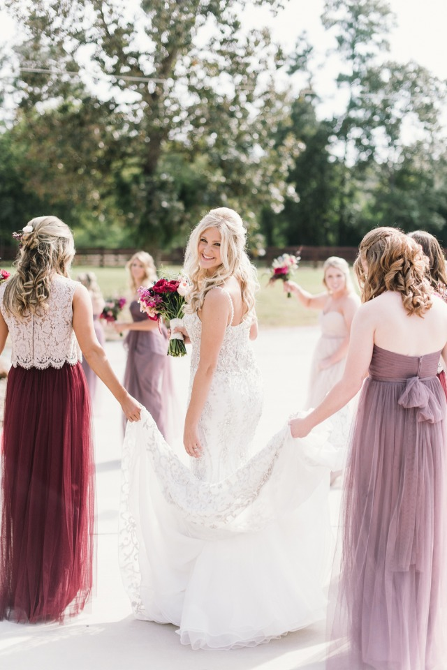 bride and her berry dressed bridesmaids