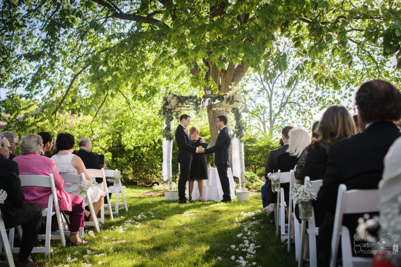 Adam and Jim's ceremony in the gardens at FEAST at Round Hill, Hudson Valley wedding venue. Photo by Chris Carter Photography.