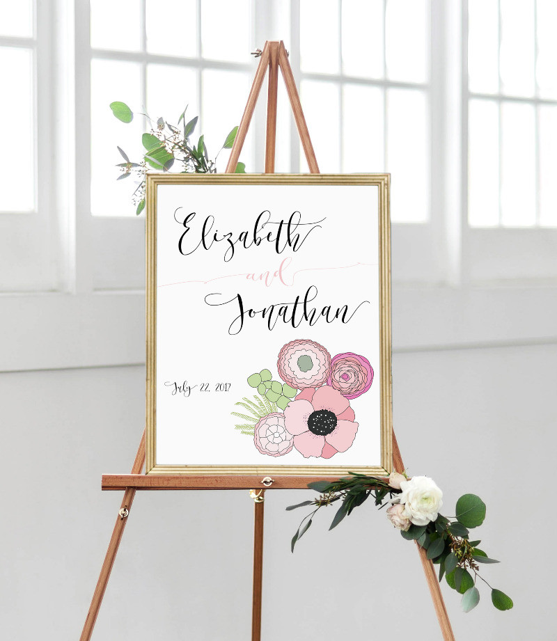 Wedding welcome sign with a fresh poppy floral bouquet in dainty pink tones.