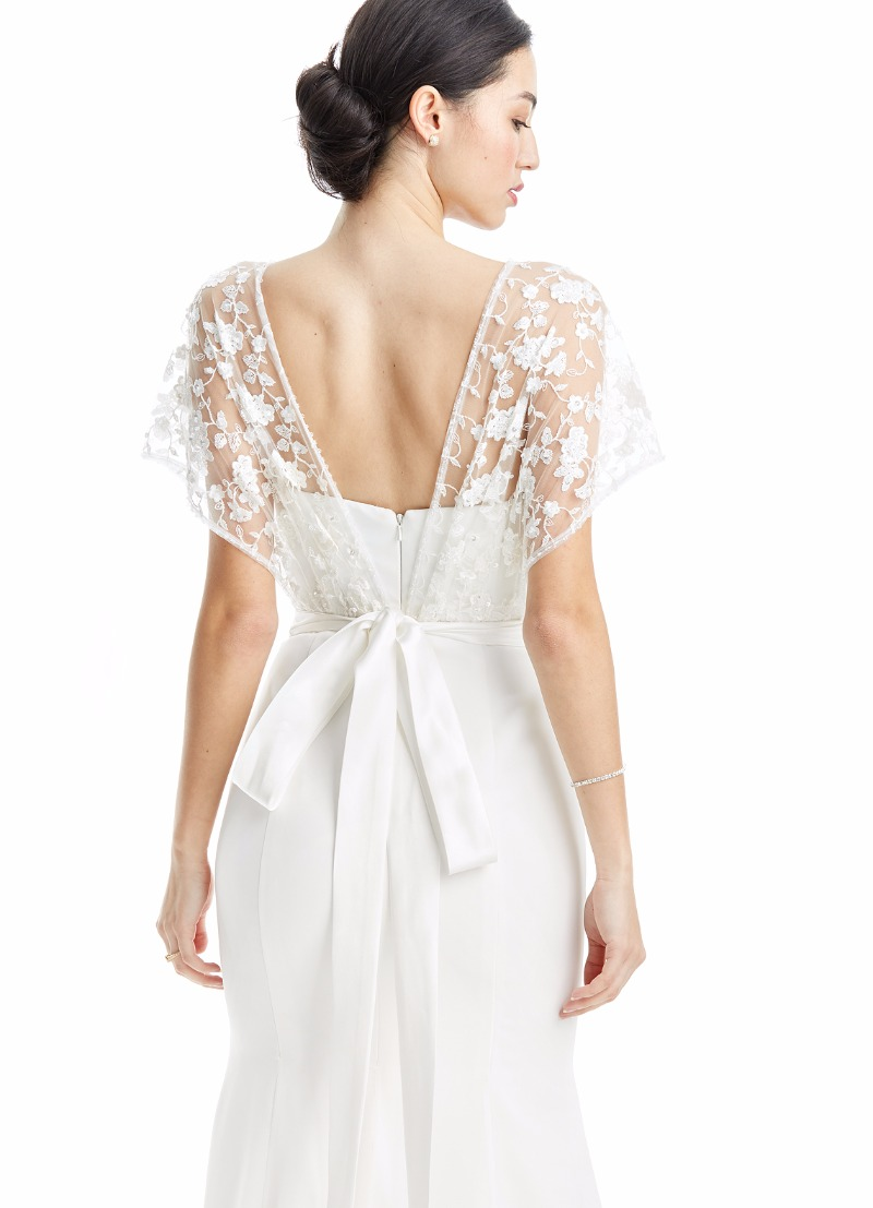 How cute is the lace overlay on this wedding dress?