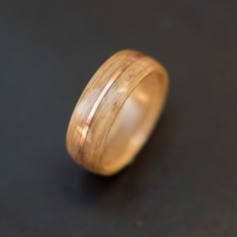 Mens bentwood wedding ring handcrafted out of solid oak with a copper strip going through the center.