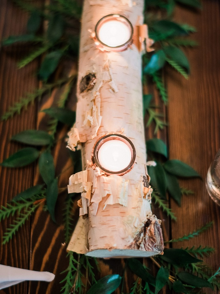 birch log and greenery centerpieces