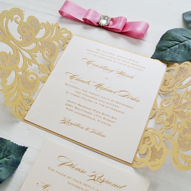 Adding the finishing touches to our gorgeous metallic gold and pink laser cut invitations with oval diamond buckles.