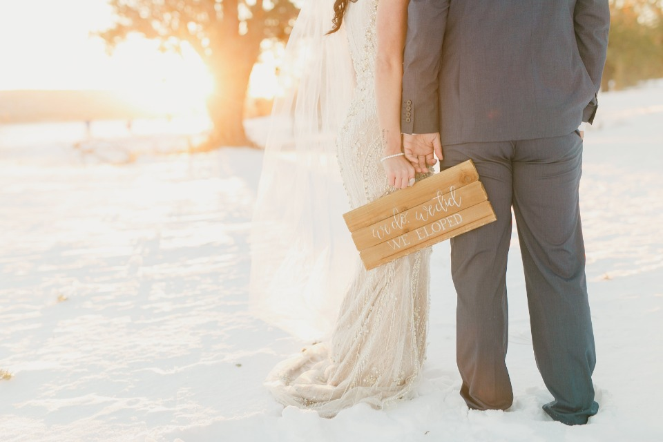 bride and groom in the now at golden hour