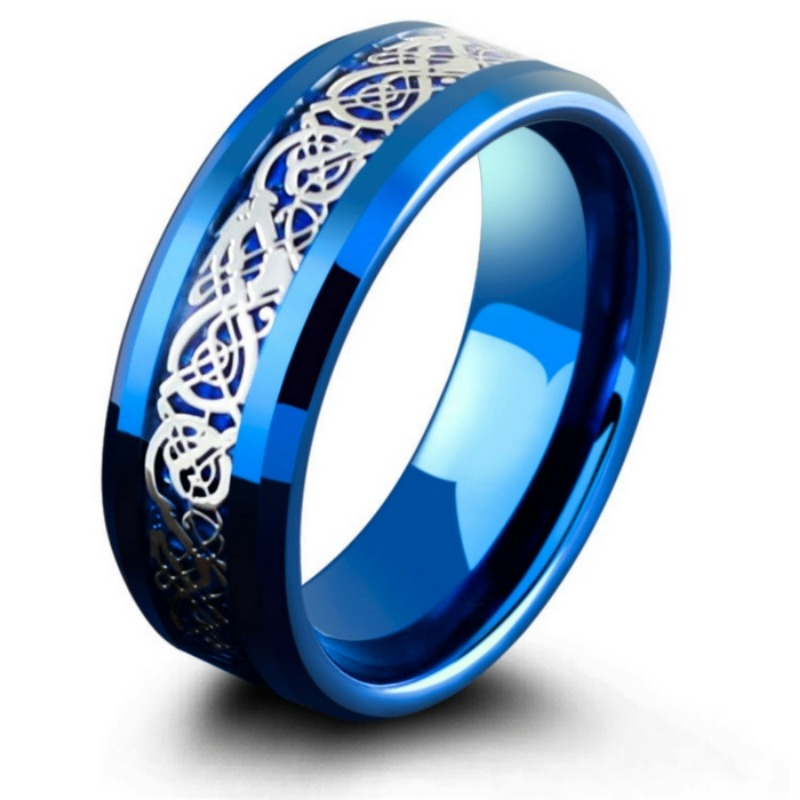 Mens blue tungsten wedding ring designed with a silver celtic inlay resting on top of a blue carbon fiber inlay.