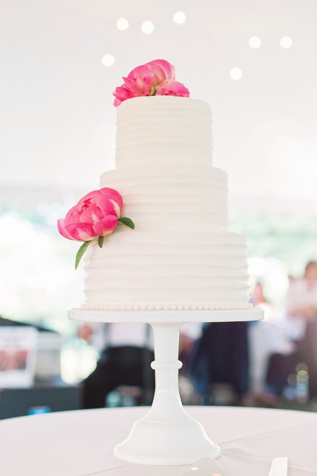 wedding cake topped with simple pink flowers