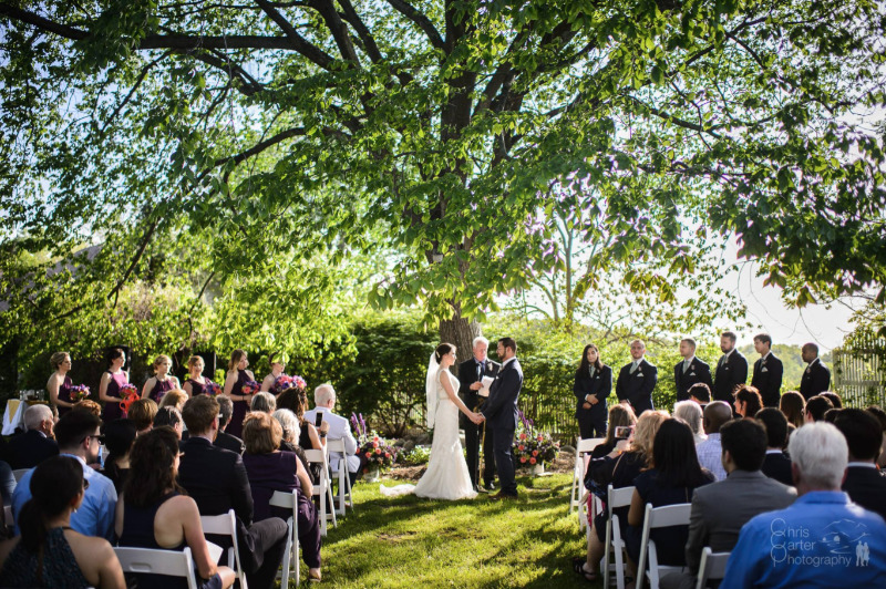 Wedding ceremony at FEAST at Round Hill, Hudson Valley wedding venue. Photo by Chris Carter Photography.