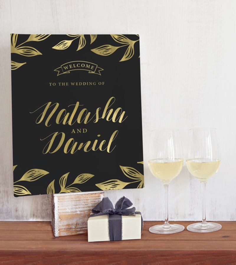 Miss Design Berry's wedding welcome sign features gold leaves and beautiful calligraphy for your names. Please note that the gold on